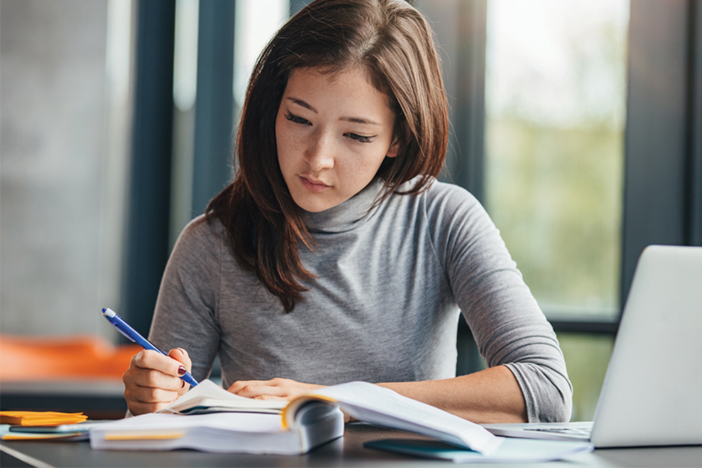 female Asian college student studying